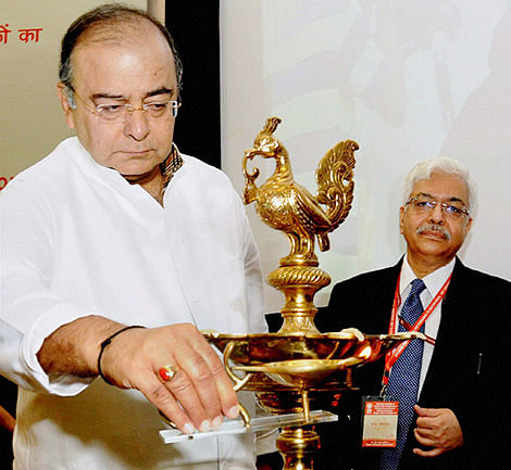 Minister for Finance, Corporate Affairs and Defence, Arun Jaitley lights the lamp as CBDT Chairman R K Tewari looks on at the inauguration of the 30th Annual Conference of Principal Chief Commissioners, Principal Director Generals, Chief Commissioners and Director Generals of Income Tax, in New Delhi on Monday.