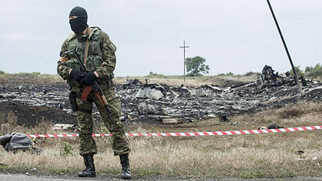 A pro-Russian fighter guarding the crash site of Malaysia Airlines Flight 17 near the village of Hrabove, eastern Ukraine.