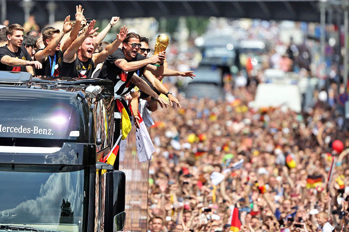 Budweiser flows… …World Cup heroes return to huge fan party