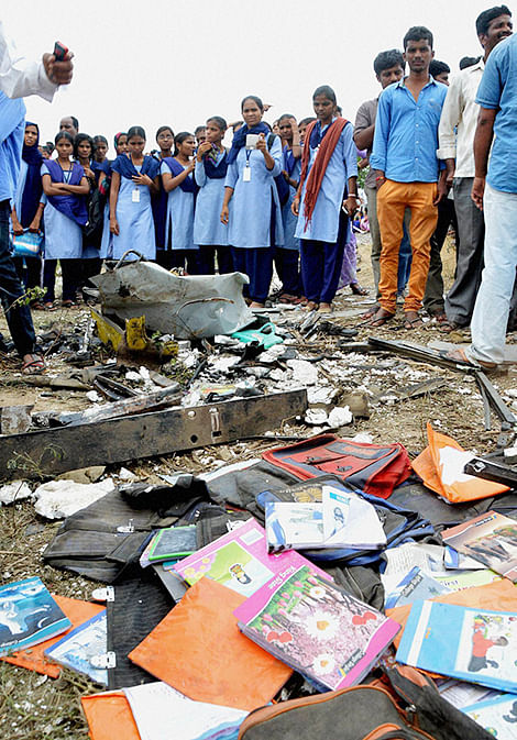Scattered books and bags of students at the site of an accident where a train crashed into a school bus.