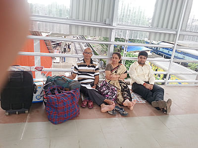A family waiting for the train arrival at CST foot over bridge on Thursday