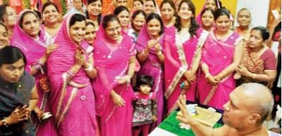 Women worship at Tapo Bhoomi to mark Suhag Dashmi