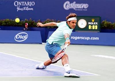 Federer, Wawrinka advance in Toronto