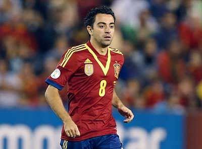 Spain midfielder Xavi calls time on international career