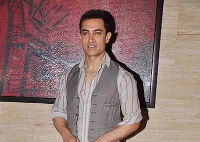 Aamir reacts to SRK's dig on nude PK poster