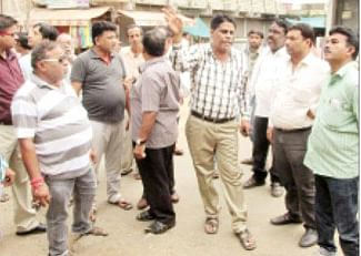 Commissioner inspects area to broaden road
