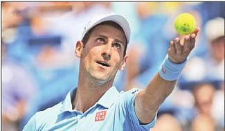Djokovic out, Federer survives