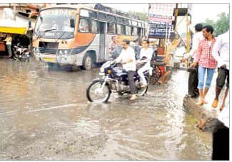 Heavy rain lashes city, brings smiles