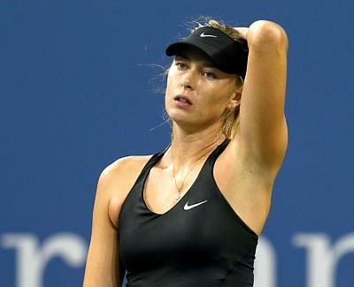 Sharapova ousted by Wozniacki in fourth round of US Open
