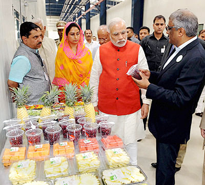 PM Modi taking a round after inaugurating India Food Park, India's first state-of-the-art integrated food park, in Tumkur on Wednesday. Union Food Processing Minister Harsimrat Kaur Badal is also seen.  Photo(PTI9_24_2014_000204