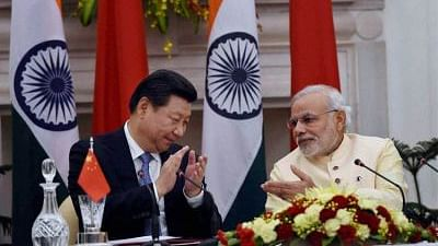 Prime Minister Narendra Modi and Chinese President Xi Jinping at the agreement signing ceremony at Hyderabad House in New Delhi