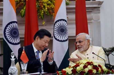 New Delhi: Prime Minister Narendra Modi and Chinese President Xi Jinping at the agreement signing ceremony at Hyderabad House in New Delhi on Thursday. PTI Photo by Subhav Shukla