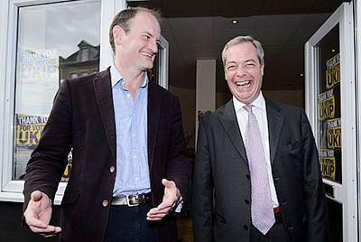 Newly-elected UK Independence Party (UKIP) MP  Douglas Carswell (L) and party leader Nigel Farage pose for pictures outside the party's local office in  Clacton-on-Sea, in eastern England.