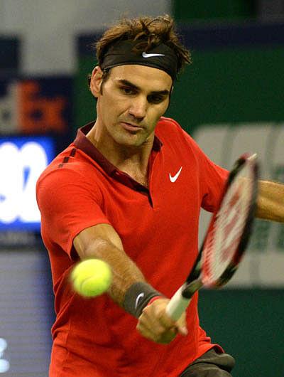 Federer outguns Djokovic