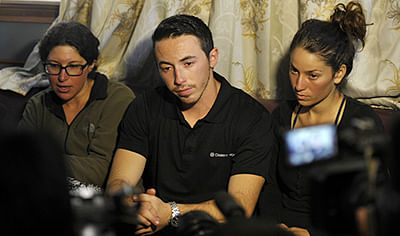 Israeli trekkers Maya Ora (L), Yakov Megreli (C) and Linor Kajan (R), who were rescued by the Nepalese army following an avalanche, talk to media.