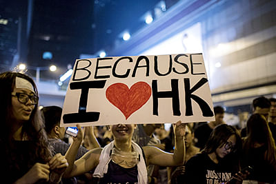 A woman holds a placard at a large pro-democracy protest in HK.
