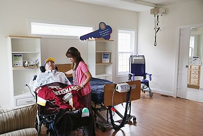 Wounded warrior U.S. Army Specialist Jay Briseno (Retired) (L) and his mother Eva Briseno get settled into their new residence in Virginia. Briseno became a quadripelgic after being shot in the head while serving in Iraq in 2003 and his parents have worked full-time to care for him since then. The Quality of Life Foundation, Azalea Charities and Helping A Hero worked together to raise $570,000 in labor, materials and contracting to build the home with an accessible bathroom with a roll in shower, lift system, a home therapy room and a screened-in porch and deck.