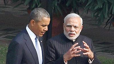 Prime Minister Narendra Modi and US President Barack Obama stroll in the gardens of Hyderabad House in New Delhi