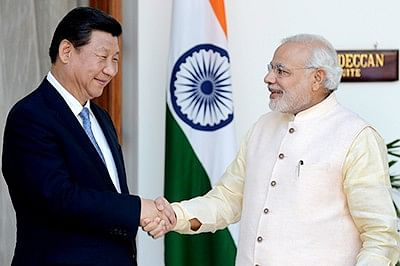 Prime Minister Narendra Modi (R) greets  Chinese President Xi Jinping in this file photo.