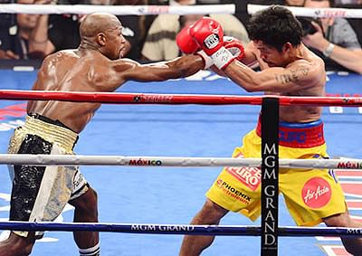 Mayweather vanquishes Pacquiao  to extend 'perfect boxing record'