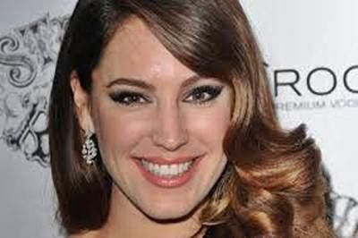 For model-actress Kelly Brook, love comes first