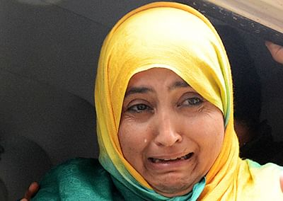 A Kashmiri woman cries next to the body of a youth at a hospital in Srinagar who was killed in an attack on a telecom company's outlet by suspected militants on Monday.