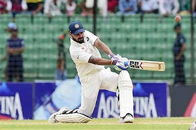 Indian cricketer Murali Vijay plays a shot during the third day of the Test match between Bangladesh and India at Khan Shaheb Osman Ali Stadium in Narayanganj on June 12, 2015.  AFP PHOTO/ Munir uz ZAMAN