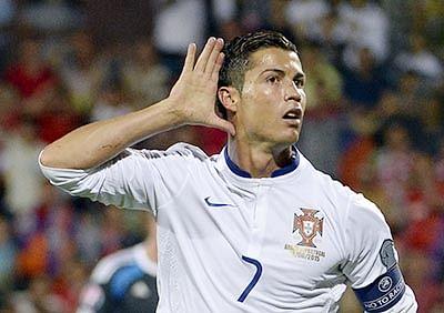 Portugal win on Ronaldo treble