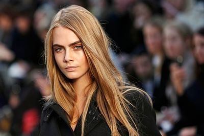 Cara Delevingne compares herself to Charlize Theron