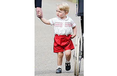 Prince George's christening outfit a big rolling hit