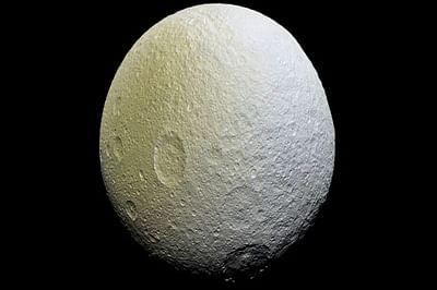 NASA probe spots unusual red arcs on icy Saturn moon