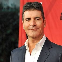 Simon Cowell hospitalised with broken back