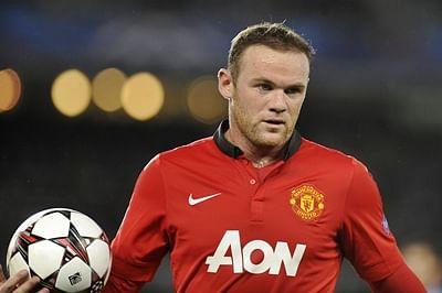 Wayne Rooney treble seals Champions League return