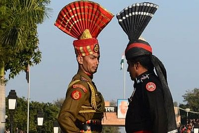 Pakistani Rangers (R) and Indian Border Security Force personnel (L) perform the 'flag off' ceremony at  Pakistan-India Wagah Border Post