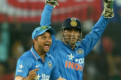 India's captain Mahendra Singh Dhoni (R) and Suresh Raina after