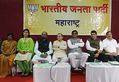 Mumbai: CM of Maharashtra, Devendra Fadanivs, with BJP State President Rao Saheb Danawe and Revenue Minister Eknath Khadase and Party leaders at BJP State council meeting at Dadar Mumbai office, in Mumbai on Thursday.  (Photo by Bhushan Koyande)