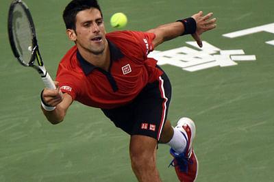 Djokovic ticks on as Tomic bombs