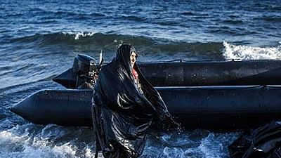 TOPSHOTS An elderly woman is pictured after arriving on the Greek island of Lesbos, after crossing the Aegean sea from Turkey, on October 15, 2015. More than 400,000 refugees, mostly Syrians and Afghans, arrived in Greece since early January while dozens were drowned trying to make the crossing. In total 710,000 have entered the EU through Greece and Italy during the same period, according to the European Agency Frontex border surveillance. The migration issue has caused deep divisions within the European Union, which is trying to set the distribution of migrants among its member countries or limit the flow.    AFP PHOTO / DIMITAR DILKOFF