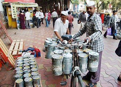 Need for speed: Dabbewalas ditch cycles for mopeds