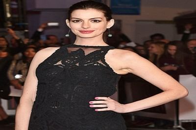 Anne Hathaway debuts baby bump in public