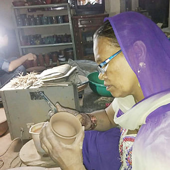 Inflation and cheap 'Chinese' lights mar Delhi potters' Diwali