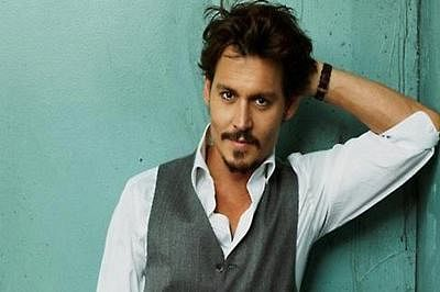 Johnny Depp kisses Jimmy Kimmel onscreen