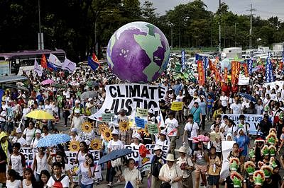 Protesters attend a climate change march on a highway in Manila.