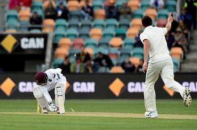 Hobart : West Indies' Denesh Ramdin, left, is bowled Australia's Josh Hazlewood, right, during their cricket test match in Hobart, Australia, Friday Dec. 11, 2015. AP/PTI(AP12_11_2015_000012B)