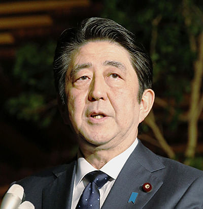 "Japanese Prime Minister Shinzo Abe speaks to the press at his official residence on December 28, 2015, after a telephone conversation with South Korean President Park Geun-Hye. Abe said that a landmark agreement between Japan and South Korea on the issue of wartime sex slaves heralds a ""new era"" in relations between the two countries.    AFP PHOTO / JIJI PRESS    JAPAN OUT"