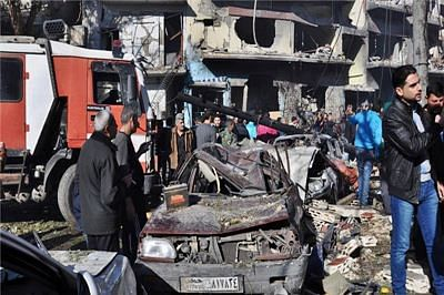 At least 14 killed in bomb blasts in Syria's Homs: state media