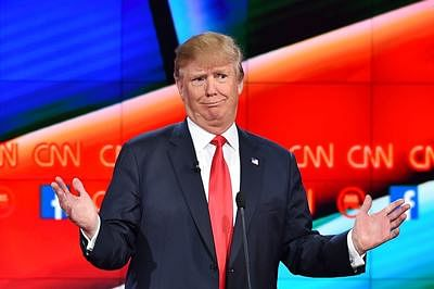 (FILES) - A file picture taken on December 15, 2015 in Las Vegas, Nevada, shows Republican presidential candidate Donald Trump during a presidential debate. Good. Bad. Stupid. When it comes to his choice of words, Donald Trump keeps it simple. So simple, in fact, that even a nine-year-old can get what the Republican White House frontrunner is saying, according to a test developed for the US Navy.  AFP PHOTO/ ROBYN BECK