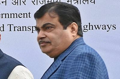 New Delhi: Prime Minister Narendra Modi with Union Road Transport and Highways Minister Nitin Gadkari during a function for the launch of an electric bus to ferry lawmakers to Lok Sabha, at Parliament House in New Delhi on Monday. PTI Photo by Manvender Vashist(PTI12_21_2015_000152B)