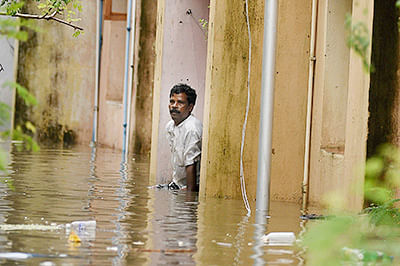Chennai: A man seeking help from his water logged house at Kotturpuram after heavy rains in Chennai on Wednesday. PTI Photo by R Senthil Kumar (PTI12_2_2015_000133B)