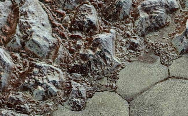 See mesmerising Pluto in colour now